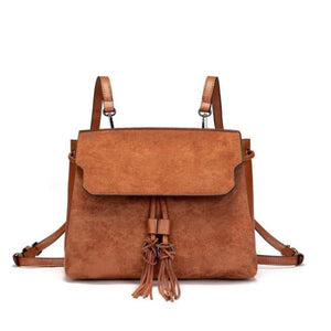 Brown backpack purse with tassels