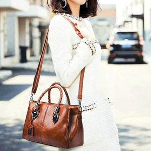 Brown leather shoulder bag with triple pocket compartment