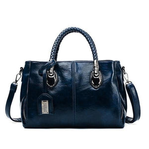 Blue leather handbag with triple compartment
