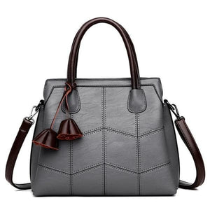 Gray leather cross body handbags with top handles