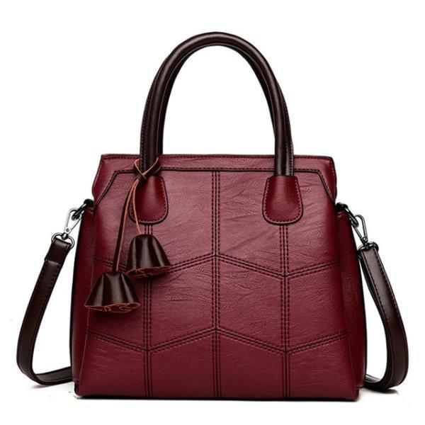 Red leather cross body handbags with top handles