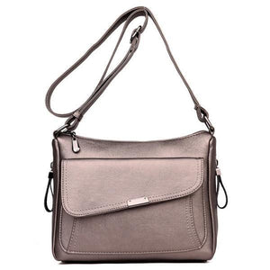 Bronze leather crossbody bag with large front pocket