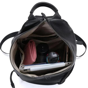 Wide opening genuine leather backpack