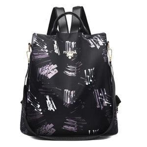 black and gray backpack purse