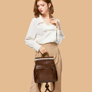 Dark brown leather backpack crossbody purse