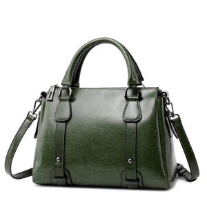 Green leather crossbody purse with handles