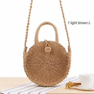 Light brown round straw crossbody bag with handle