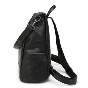 Black leather backpack with side bottle pocket