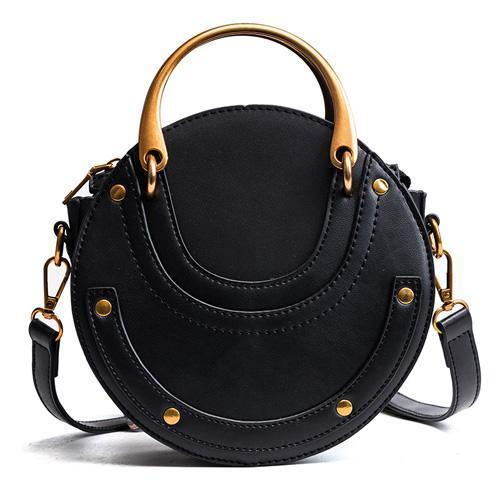 Black round crossbody bag with metal handles