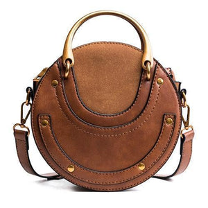 Brown round crossbody bag with metal handles