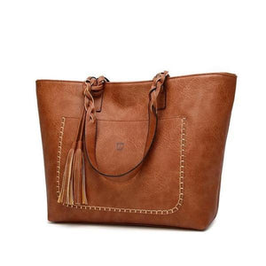Brown leather tote bag with tassels