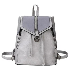 Gray leather convertible backpack purse with crossbody strap