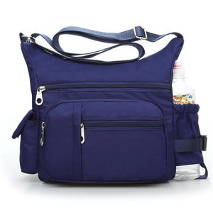 Blue crossbody bag with water bottle holder