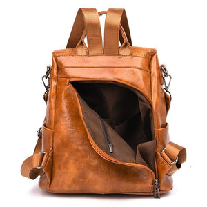 Brown leather backpack with rear hidden pocket