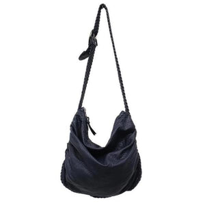 Navy blue vegan crossbody bag with woven leather strap