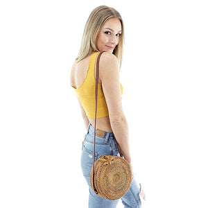 round rattan bag with leather strap