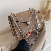 Small one - shoulder bag in abrasive leather