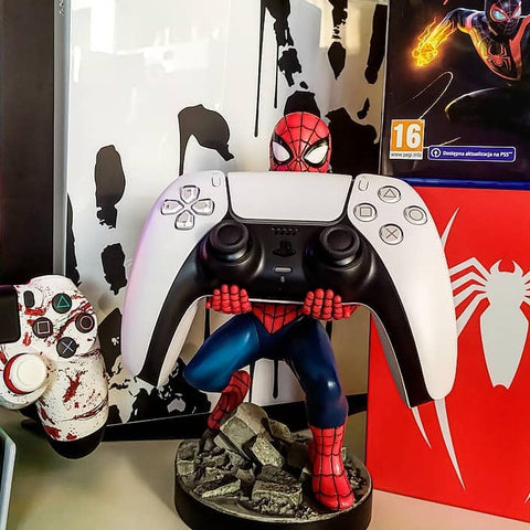 The Amazing Spider-man Cable Guy holding PS5 Controller