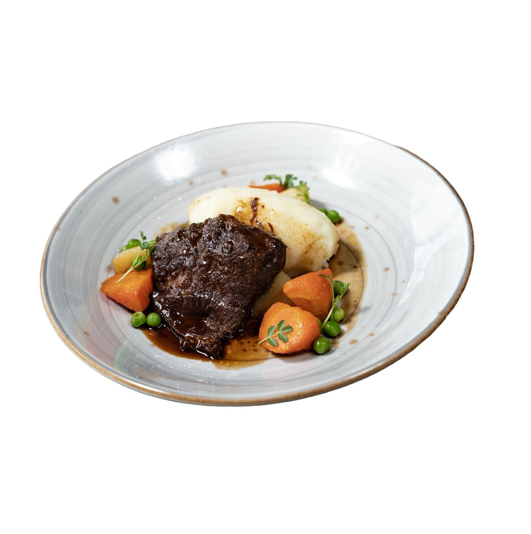 Slow braised beef cheek, mash potato, roasted vegetables, peas & gravy