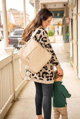 Mother and child walking with diaper bag