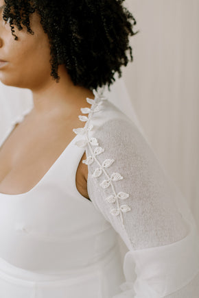 Wedding Shrug made from sustainable 100% Cashmere. Hand crochet silk vines adorn the neckline.  Detail view