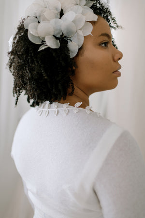 Wedding Shrug made from sustainable 100% Cashmere. Hand crochet silk vines adorn the neckline.  Detail back view