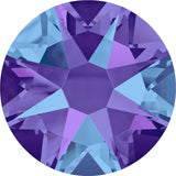 Stock photo of Swarovski Crystal Xirius Rose flat back stones in Crystal Heliotrope a blue and purple mix