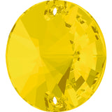 stock image of Swarovski Crystal Article 3200 Rivol sew on stone in Yellow Opal colour