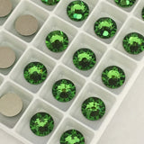 real photo of Swarovski Crystal Fern Green flat backs with platinum foiling