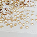 actual image of golden shadow cabochons crystals from Swarovski pale gold unfaceted domes