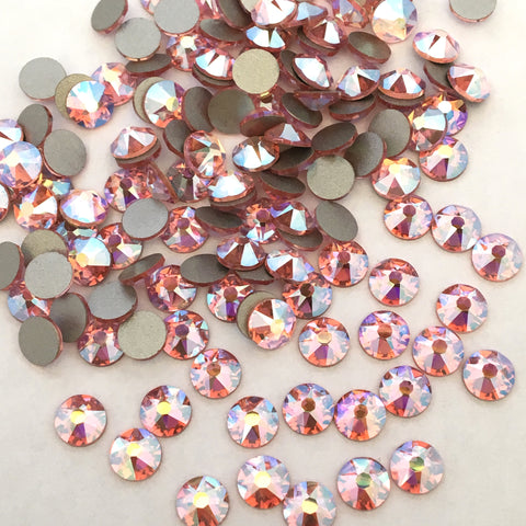 actual photo of Swarovski Crystal Light Rose AB faceted flat backs to glue on
