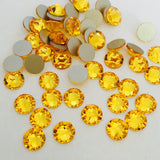 real photo from above of glue on XIRIUS Rose crystals in Sunflower colour