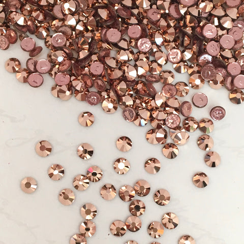 real photo of Swarovski Crystal Hotfix rhinestones in Rose Gold tiny sizes