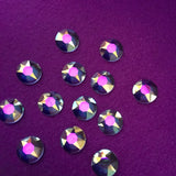 purple satin showing through the transparent stones of Swarovski Crystal Transmission