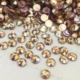 actual photo of Swarovski Crystal Golden Shadow effect on a flat back stone gold toffee colour