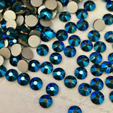 real photo of Swarovski No Hotfix XIRIUS Rose stones in Metallic blue a shiny dark blue faceted diamanté