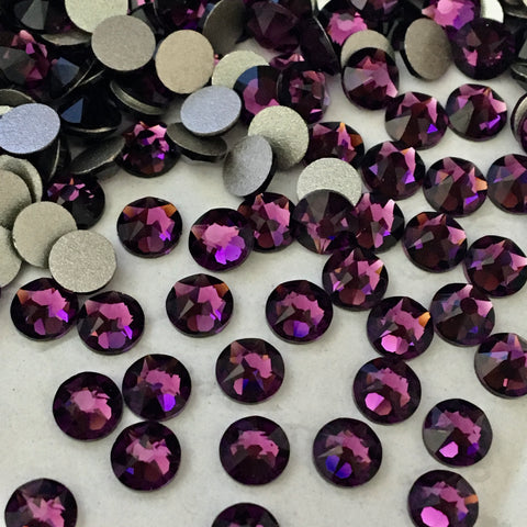 actual photo of scattered Swarovski flat back crystals in the colour Amethyst