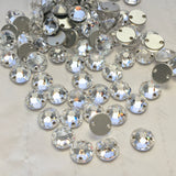 real photo of Swarovski Crystal Article 3288 XIRIUS sew-on stones round with flat back in clear colour