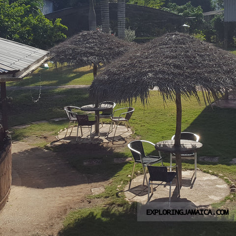 thatch roofed lawn tables