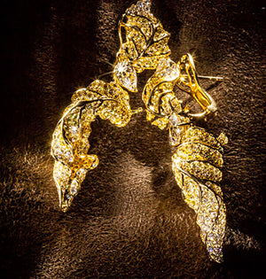 Feuille D'Or, or Golden Leaf, earrings set with yellow and white diamonds.