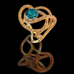 Kephi ring in teal blue and orange sapphires
