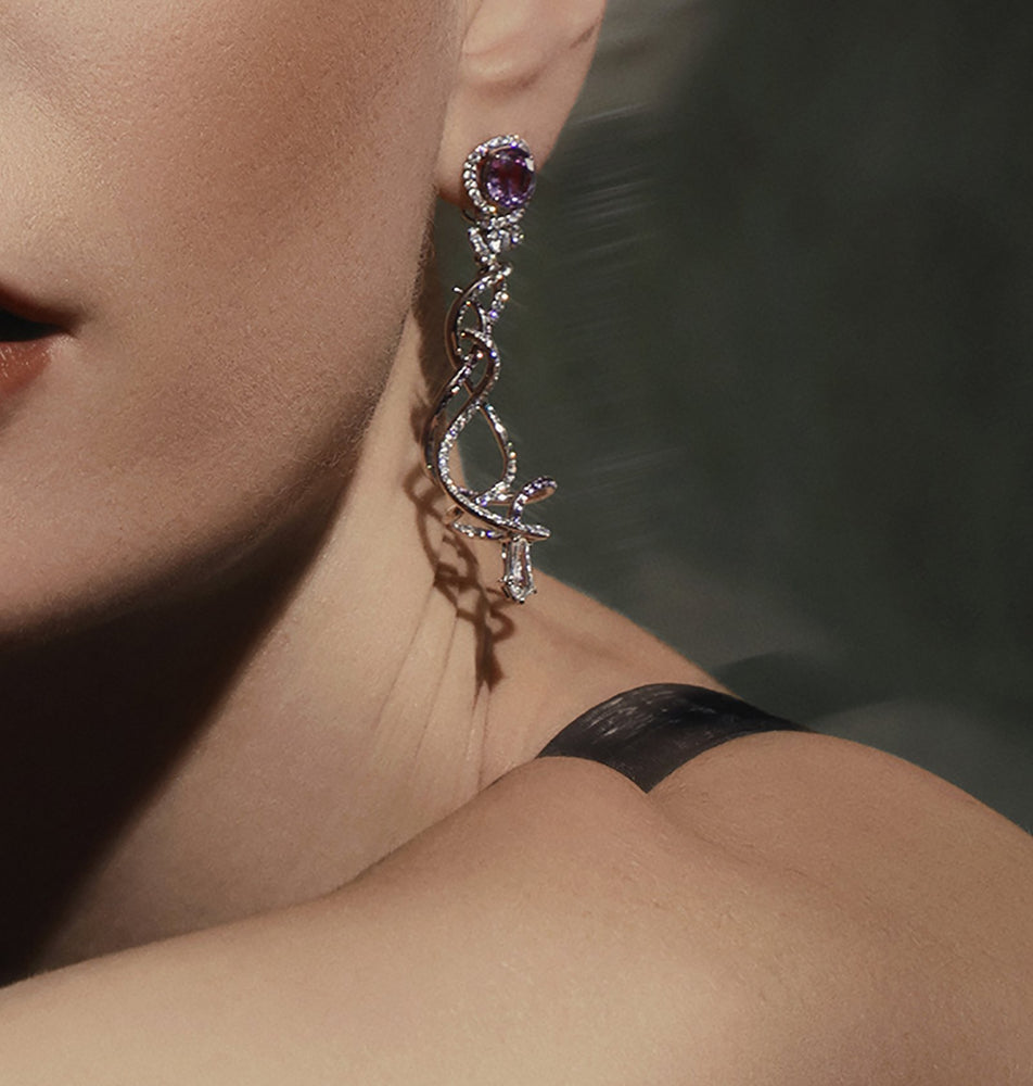 Load image into Gallery viewer, Advay earrings in spirals of diamonds and purple sapphires.