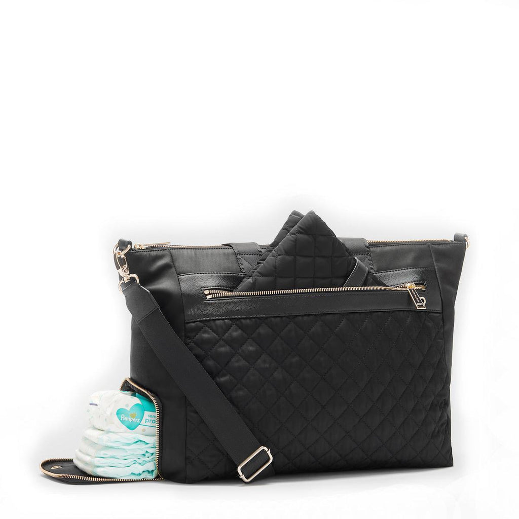 large black changing bag with baby mat FACT + FICTION