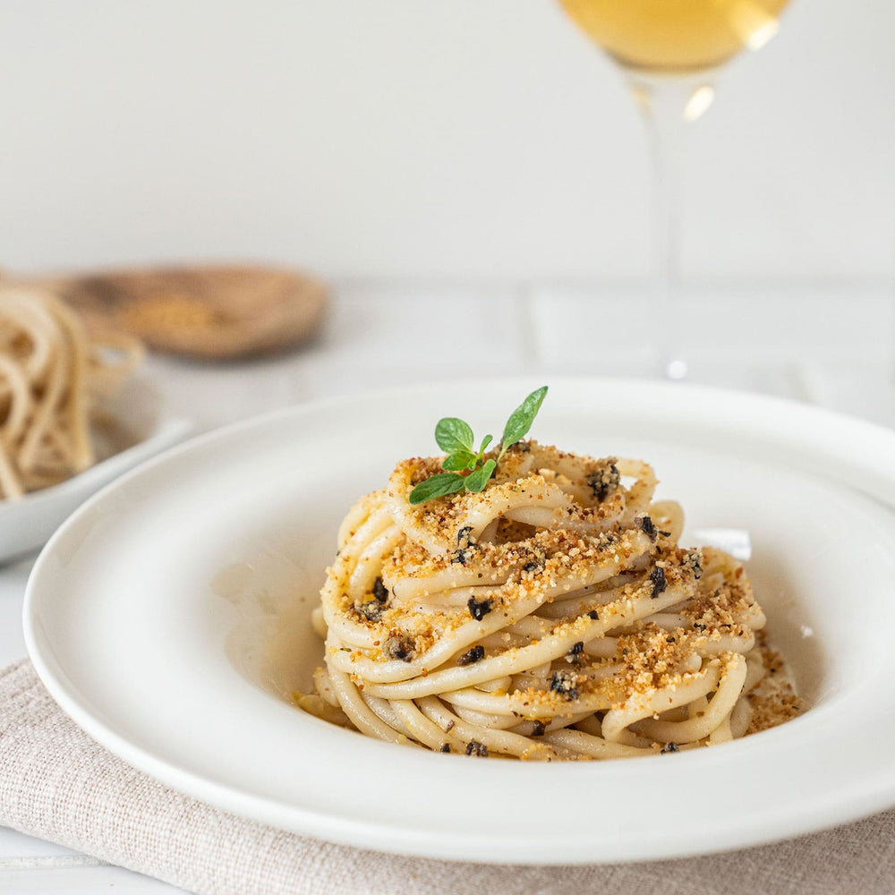 Load image into Gallery viewer, Pici pasta with truffles, breadcrumbs and anchovies