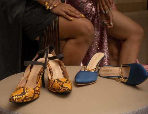 Don't Call Me Princess' snake print yellow 3 inches heels with back strap and blue pointed toed mule heels with golden chain