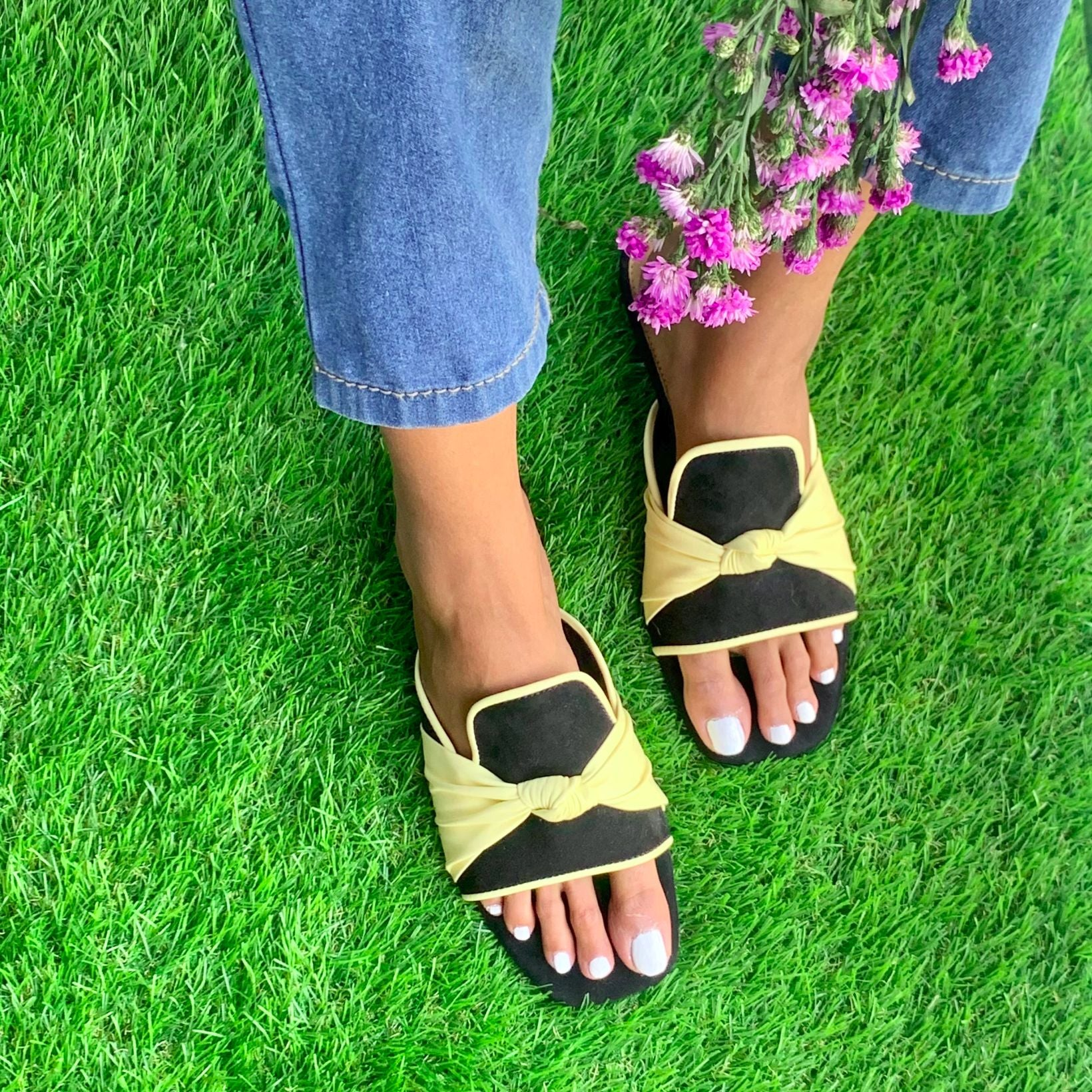 knotted black and yellow slip on flats for women
