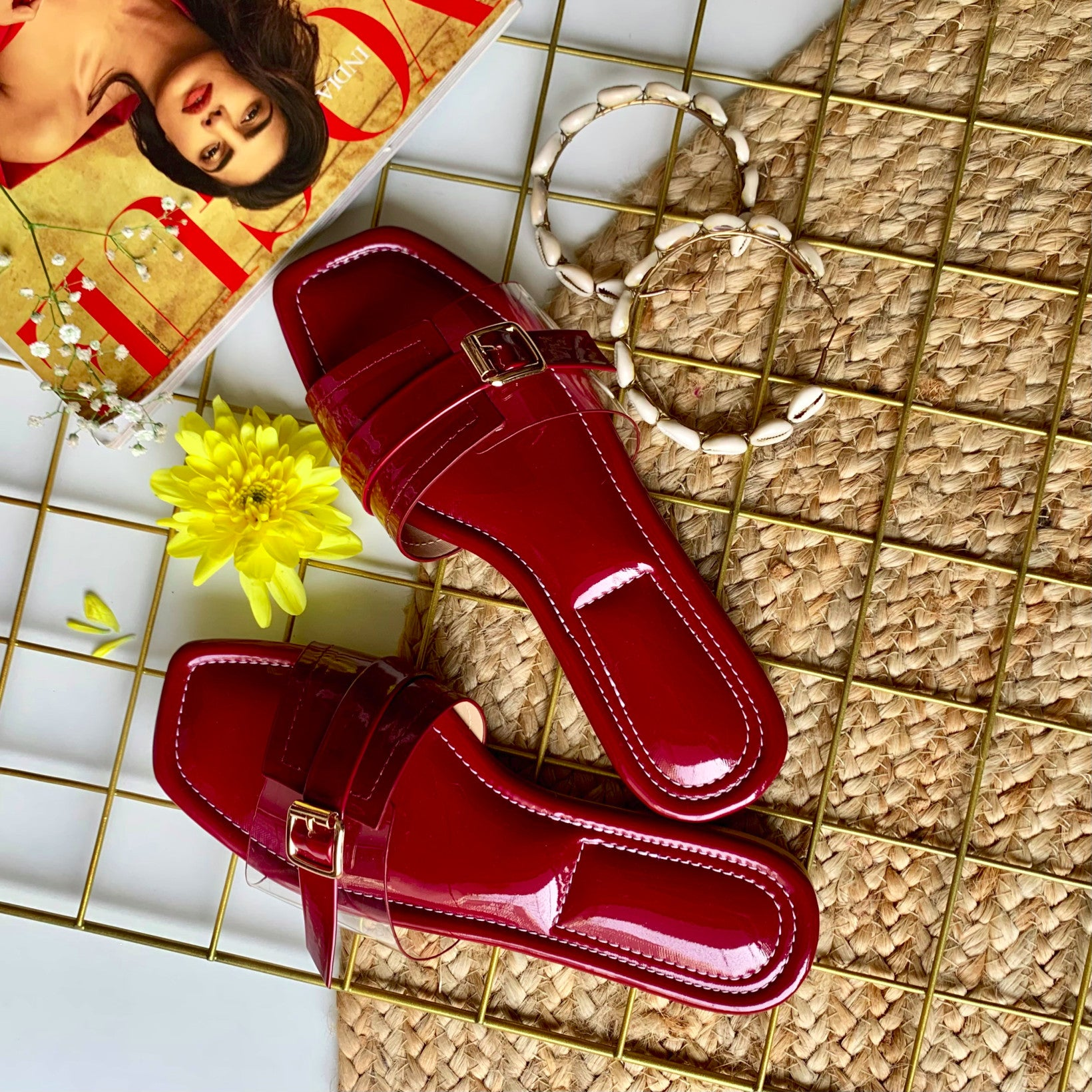 maroon slip on flats with buckle pattern