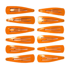 Mia® Spirit Line Snip Snaps® high gloss paint - orange color - 12 pieces shown out of the packaging - designed by #MiaKaminski of #MiaBeauty #beauty #hair #hairclips #hairaccessories #barrettes