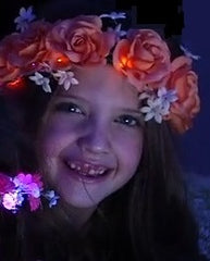 Mia® Beauty Flashion Flowers - LED lighted headband -orange roses shown on model from commercial