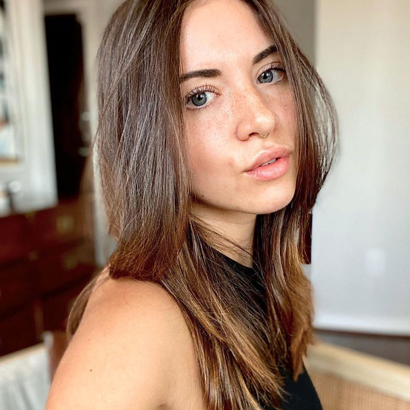 warm brown hair color on person with medium length hair